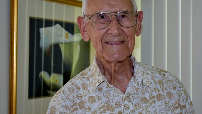Gene Willem at home a day after celebrating his 100th birthday. The avid dancer is also an accomplished watercolorist.