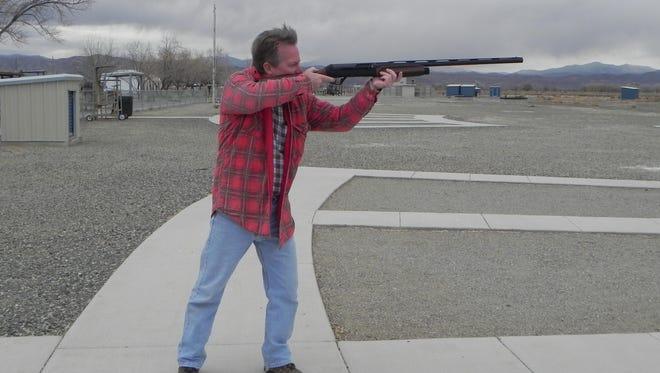 Mike Perumean of Yerington takes aim during the Yerington Lions Club turkey shoot Sunday at the Yerington Gun Club trap range.
