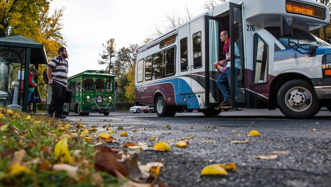 Passengers get off the Route 250 Connector bus in Staunton on Wednesday, Oct. 28, 2015.