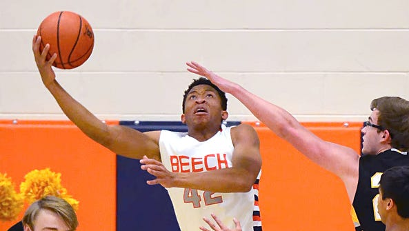 Beech High senior forward Caleb Walton elevates for