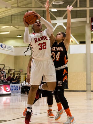 City College of San Francisco's Nahrie Pierece, left, attempts a shot while being guarded by Ventura College's Sienna Brown during the CCCAA state quarterfinals at Las Positas College in Livermore on Friday night. Ventura won 79-66.