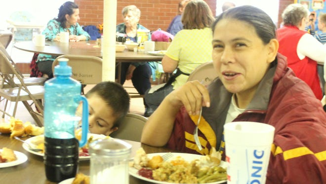 The Otero County Hunger Coalition served 335 Thanksgiving meals at Our Savior Lutheran Church Thursday afternoon.