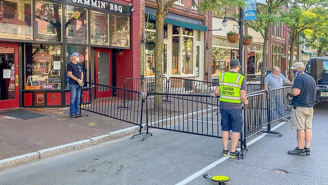 Work started early Friday to get set up for new outdoor eating areas and other outdoor business activities on Market Street, as the street closed to vehicle traffic through Aug. 1.