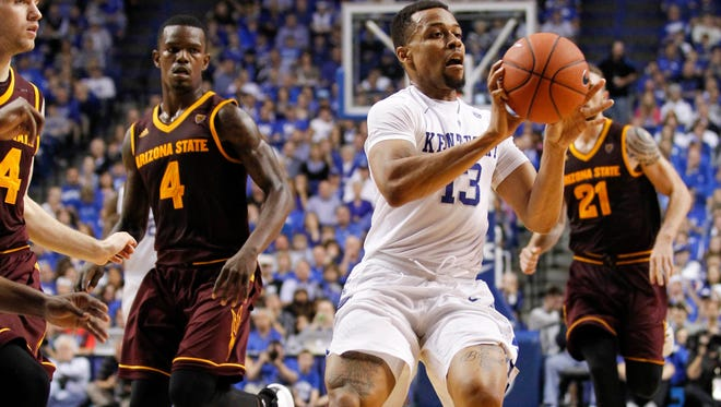Dec 12, 2015; Lexington, KY, USA; Kentucky Wildcats guard Isaiah Briscoe (13) passes the ball against Arizona State Sun Devils guard Gerry Blakes (4) and forward Eric Jacobsen (21) in the second half at Rupp Arena. Kentucky defeated Arizona State 72-58. Mandatory Credit: Mark Zerof-USA TODAY Sports