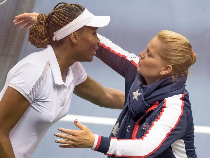Venus Williams and USA captain Kathy Rinaldi hug after