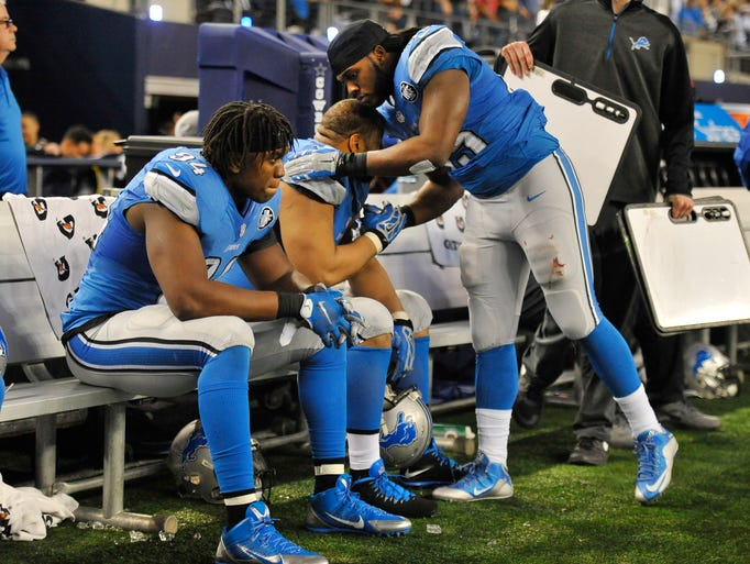 LIons running back Joique Bell, right, consoles Ndamukong