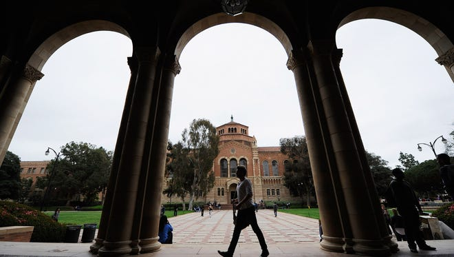 A student walks near Royce Hall on the campus of UCLA on April 23, 2012 in Los Angeles, Calif.