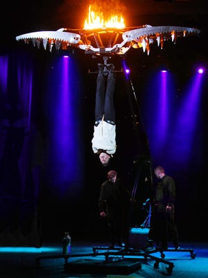 "Illusionist Jay Owenhouse hangs upside down, ready to escape the ""Jaws of Death."" Although Owenhouse has been injured several times by this trick, he brings it back because his fans enjoy it so much."