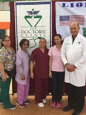 Dr. John Taitano from The Doctors' Clinic provided medical advice and answered medical questions from the attendees at the District 204 Lions Club Health Fair held on Feb. 3 at Micronesian Mall. The Guam Diabetes Association, representatives from StayWell, SelectCare, Moylan's Insurance Company, Quaker Oats and Guam Regional Medical Center participated in the event. Pictured at the Health Fair on Feb. 3 from left: Anjaneen Taitano, RN, Carol Olivares, LPN and nurses' aides Bernie Atoigue and Tanya Jesus and Dr. John Ray Taitano.