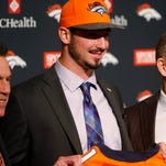 Broncos first-round selection Paxton Lynch, center, is introduced by coach Gary Kubiak, left, and general manager John Elway.