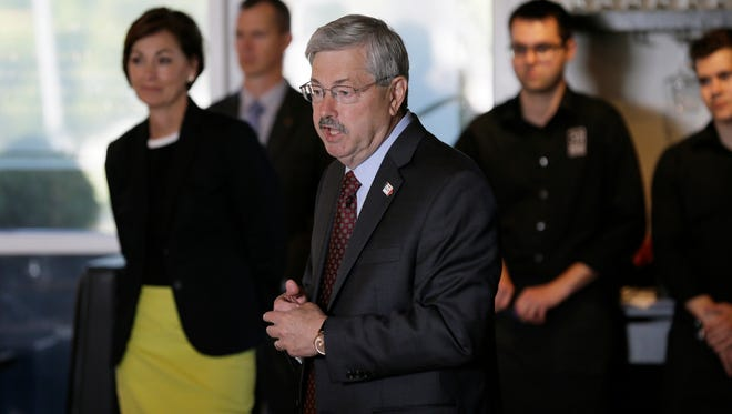 FILE - In this May 29, 2014, file photo, Iowa Gov. Terry Branstad, center, speaks during a campaign stop in Ames, Iowa. Branstad began his re-election campaign in earnest last week, and even his Democratic opponent?s campaign acknowledged the odds favor the Republican will win a record sixth term. (AP Photo/Charlie Neibergall, File)