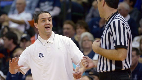 Butler head coach Brandon Miller, left, argues a call during the first half of an NCAA college basketball game against Oklahoma State at the Old Spice Classic tournament in Kissimmee, Fla., Friday, Nov. 29, 2013. (AP Photo/Phelan M. Ebenhack)