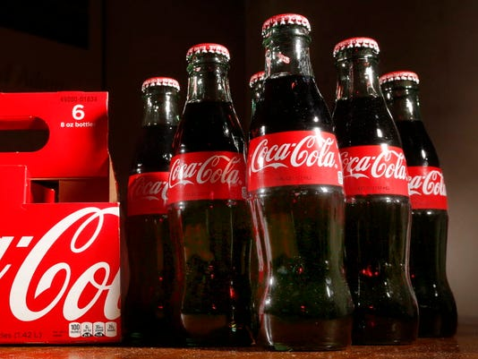 AP EARNS COCA-COLA F A USA NH