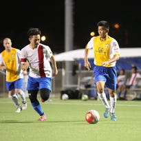 The Southern Cobras Ashton Surber attempts to navigate around Guam Shipyard defenders during a final week match of the Budweiser Soccer League Premier Division Sunday at the Guam Football Association National Training Center. Guam Shipyard won 7-1.