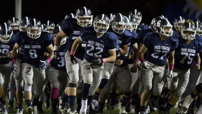 Middletown South, shown entering the field before its game with Manalapan on Oct. 16, remains the No. 1 team in the Asbury Park Press Top 10