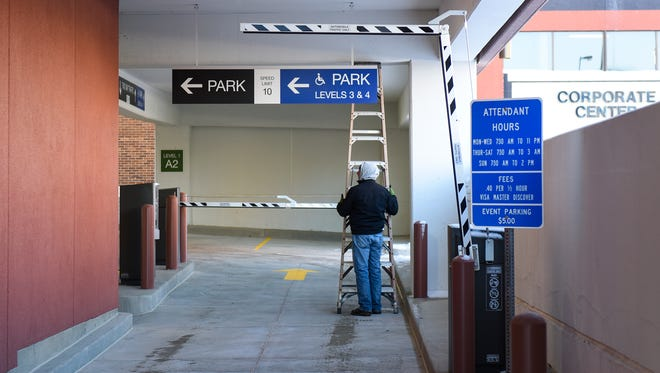 Signage is installed near the entrance Monday, Nov. 21, 2016 of the new River's Edge Convention Center parking ramp in St. Cloud.