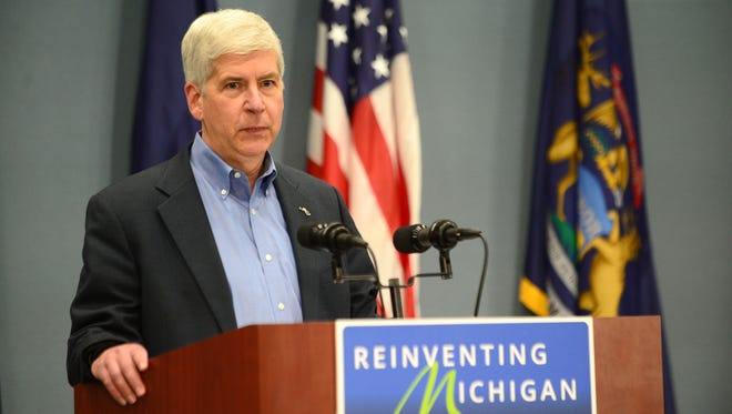 Gov. Rick Snyder speaks to the press on Wednesday, April 20, 2016 regarding the criminal charges against two state workers and a Flint city employee in regards to the Flint water crisis at the George W. Romney Building in Lansing.