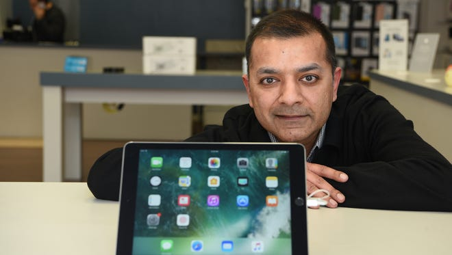 """Mudit Gupta says he sells a lot of iPads at iStore by St. Mortiz, his store in Englewood. """"For a lot of people who come to our stores,"""" he said, """"the iPad is everything."""""""