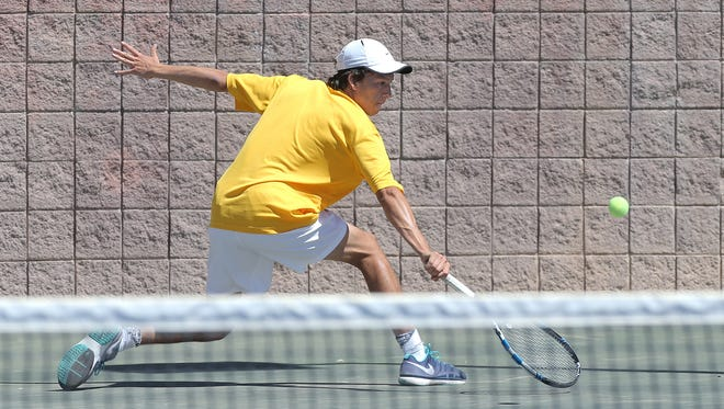 Coronado's David Cenk chases down a backhand during his District 6A championship match against Franklin's Sebastian Herrera. Cenk defeated Herrera in three sets.