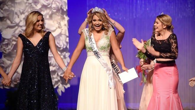 Brooklyn Harren reacts to receiving her crown during the 2017 Sauk Rapids Ambassador Pageant Thursday, June 22, in Sauk Rapids.