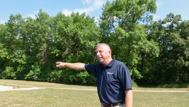 St. Cloud Mayor Dave Kleis talks about plans for a sale of about 18 acres of city land currently part of Heritage Park during a bus tour focused on economic development projects Tuesday, Aug. 1, in St. Cloud.
