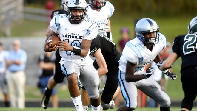 Lansing Catholic's Michael Lynn III, left, and Roje Williams, right, are two of the four players benched for Friday's homecoming game after telling school officials they planned to take a knee during the national anthem.