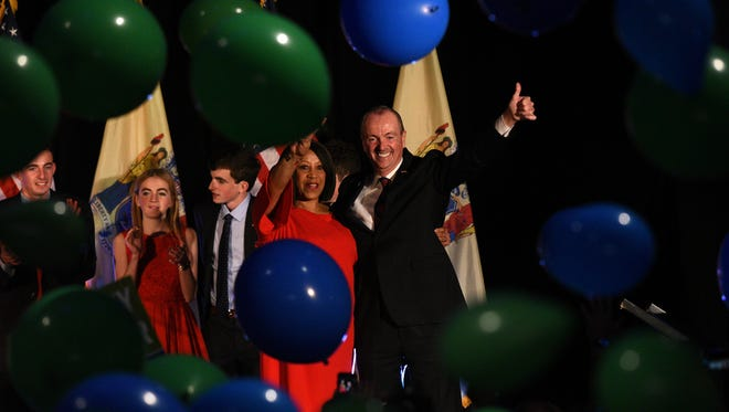 NJ gubernatorial candidate Phil Murphy and Lt. Governor Sheila Oliver celebrate their victory with supporters after the polls close on election night after defeating his opponent, Lt. Governor Kim Guadagno. Murphy celebrates at the Convention Center in Asbury Park, NJ on Tuesday, November 7, 2017.