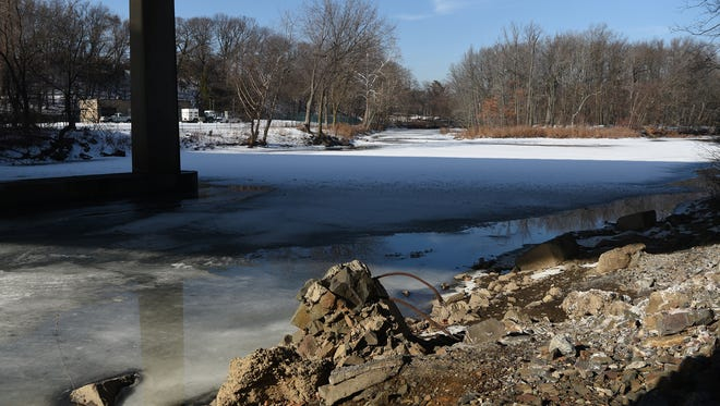 The Passaic River is running at 6 percent of normal flow. The shore of the river in Woodland Park along McBride Avenue is clearly visible on Wednesday, Jan. 10.