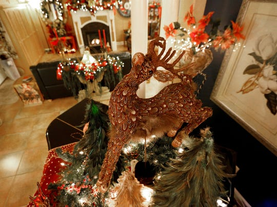 """A feathered reindeer is the """"wow"""" factor in an arrangement on top of a piano at Tom and Tass Morrison home in Sublimity."""