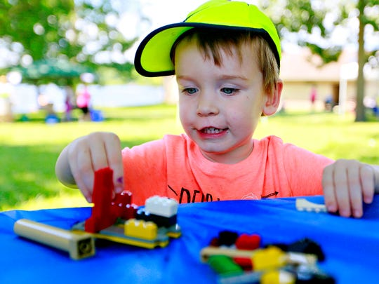 Jeffrey Heim, 2, of Dover Township, builds with legos