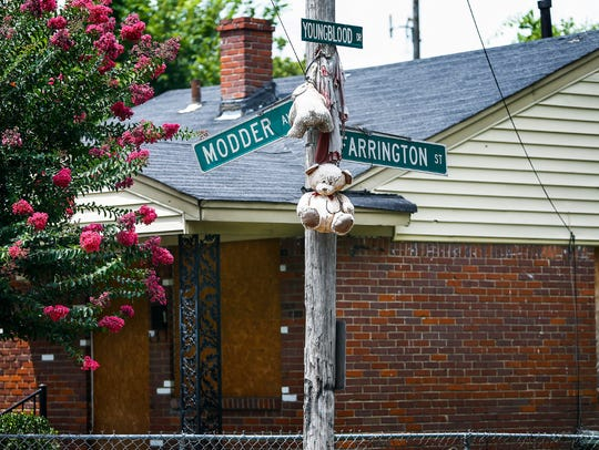 A teddy bear memorial hangs from a pole in the Riverview