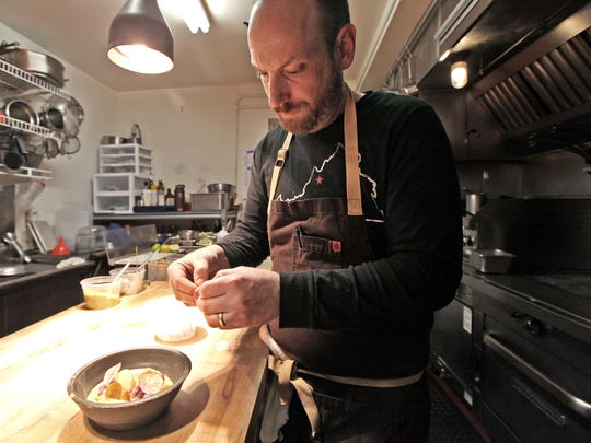 Chef Ian Boden garnishes an oyster stew with sliced radishes at The Shack in Staunton on Saturday, Dec. 2, 2017. Boden says he serves oysters to customers throughout the year in various ways from raw to fried to broiled in the half shell.