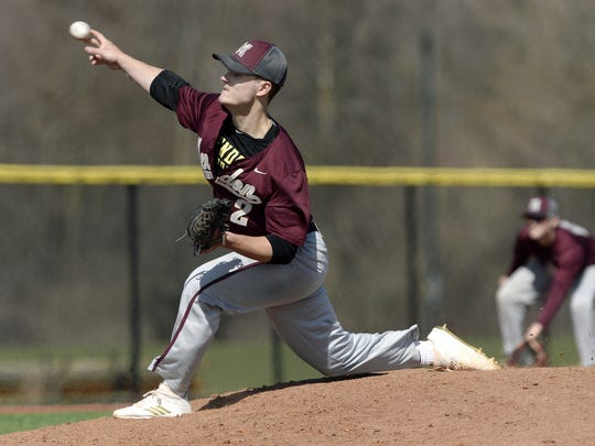 Pittsford Mendon's George Gines releases a pitch during