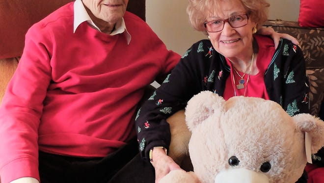 Christmas Photo – Cathy and Dale Drake pose with one of 5 bears they bought for their great grandkids.