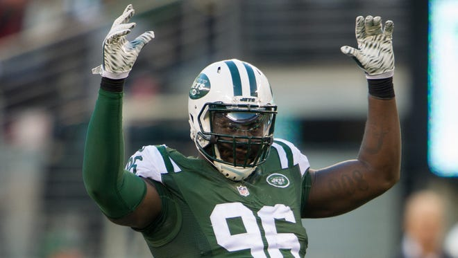 New York Jets defensive end Muhammad Wilkerson (96) reacts to the crowd in the second half of the Jets 38-20 victory over the Miami Dolphins at MetLife Stadium.