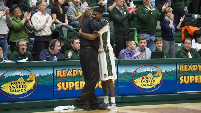 CSU coach Larry Eustachy hugs senior guard Antwan Scott as the final seconds tick off the clock Tuesday night in the Rams' 86-69 win over New Mexico at Moby Arena.