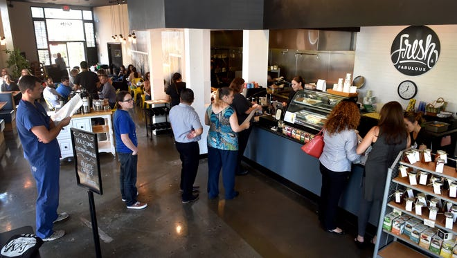 Patron line up to order during a busy lunch hour at Fresh & Fabulous Cafe in downtown Oxnard on Monday.