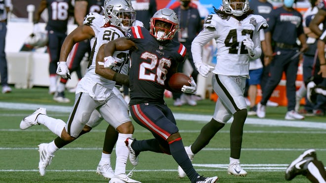 New England Patriots running back Sony Michel (26) gains yardage against the Las Vegas Raiders in the second half of an NFL football game, Sunday, Sept. 27, 2020, in Foxborough, Mass.