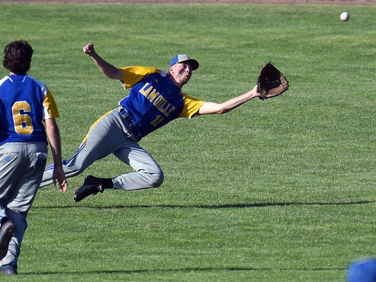 Lamoille center fielder Aidan Foley makes the diving catch during the Division II high school baseball championship at Centennial Field on Saturday, June 9, 2018.