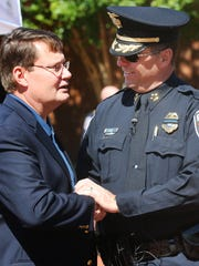 Former Murfreesboro Police Chief Glenn Chrisman, left, shakes hands with the current Police Chief Karl Durr.