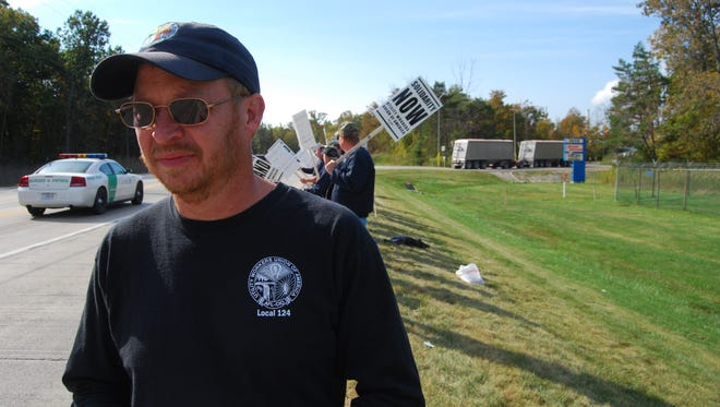 Tom Cole, of Ludington, and other utility workers from around the state set up an informational picket Thursday at Marysville Hydrocarbons.