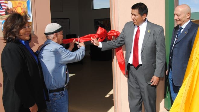 From left, Navajo Nation Office of the President and Vice President Veterans Liaison Jamescita Peshlakai, Sen. John Pinto, D-Gallup, Rural Veterans Coordination Program Northwest Region Coordinator Robertson Yazzie and New Mexico Department of Veterans' Services Secretary Jack Fox participate in a ribbon-cutting ceremony on Tuesday for the new Rural Veterans' Coordination Program office in Shiprock.