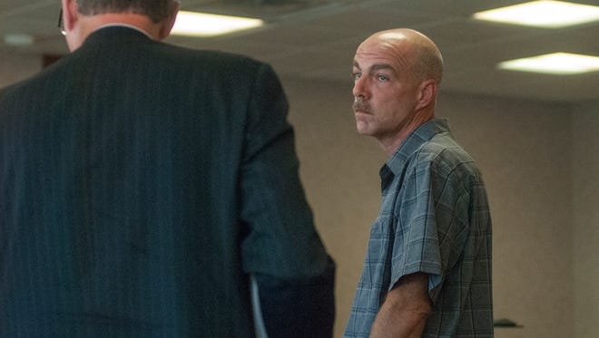 Former city employee Chad Shappee looks over to his lawyer Monday, Sept. 19, during a hearing in Judge Lane's courtroom.