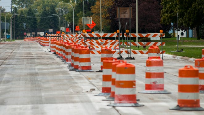 Endless construction cones are placed on 20th Street Sunday, Oct. 17, in Port Huron.