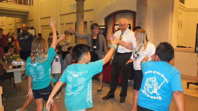 Donald Griffith, president of the Desert Sands Unified School District Board of Education, is flanked by assistant superintendent Laura Fisher and Amelia Earhart Elementary School Principal Ann Morales as her students demonstrate how to stay fit. They were participating in a recent Front and Center program.