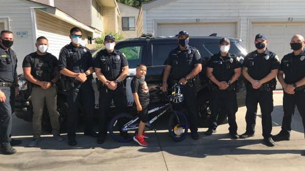 Stockton Community Response Team officers presented a new bike and helmet, along with other donated gifts, to 8-year-old Jordan Reyes of Lodi, who was struck by gunfire while watching fireworks in Stockton on the Fourth of July.