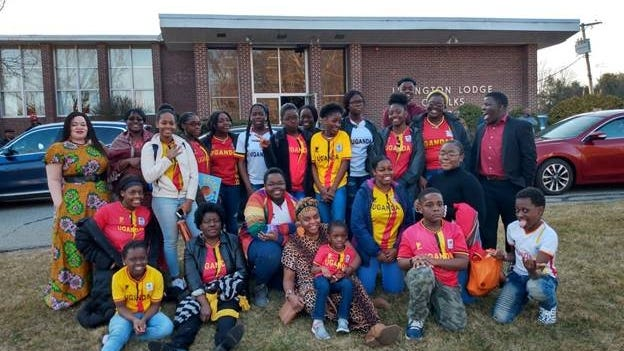 Pictured, are Africano Waltham students and families. Photo taken before COVID-19.