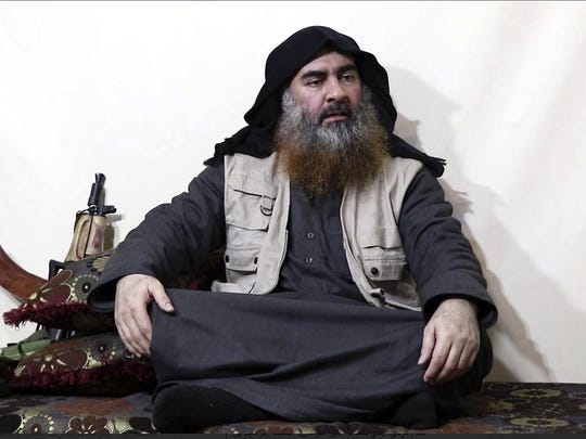 This file image made from video posted on a militant website Monday, April 29, 2019, purports to show the leader of the Islamic State group, Abu Bakr al-Baghdadi, being interviewed by his group's Al-Furqan media outlet.