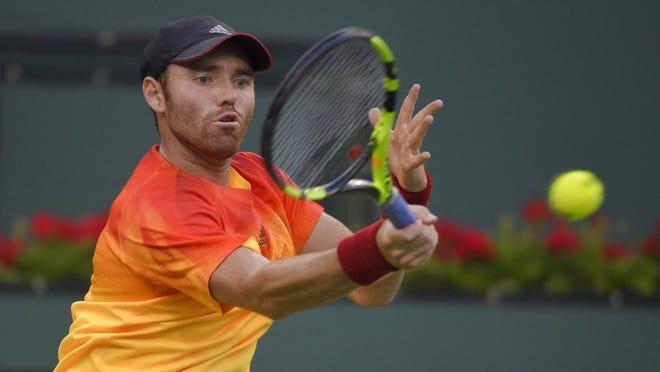 Bjorn Fratangelo returns a shot to Novak Djokovic, of Serbia, at the BNP Paribas Open tennis tournament, Sunday, March 13, 2016, in Indian Wells, Calif. (AP Photo/Mark J. Terrill)