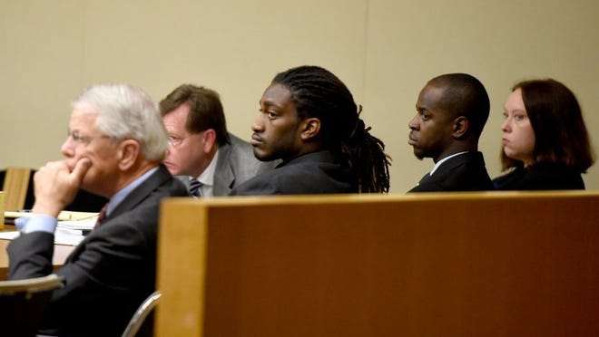 Left to right, defense attorneys Tom Dillard and David Eldridge; defendants A.J. Johnson and Michael Williams; and attorney Loretta Cravens listen during a motions hearing Tuesday, Nov. 3, 2015. Johnson and former teammate Michael Williams are charged with two counts each of aggravated rape and two counts of aiding and abetting the other in those rapes after a female athlete, then 19, told police Johnson and Williams forced her to have sex with both men during a party in November 2014.  (AMY SMOTHERMAN BURGESS/NEWS SENTINEL)